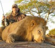 Animal tragic- Aaron Neilson poses with one of the 15 lions he has killed